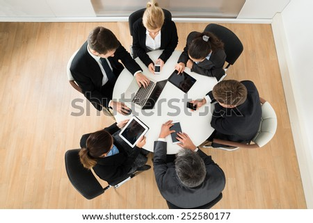 Group Of Businesspeople Using Computers and Digital Tablets - stock photo
