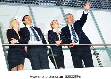 Group of businesspeople with senior boss looking forward - stock photo