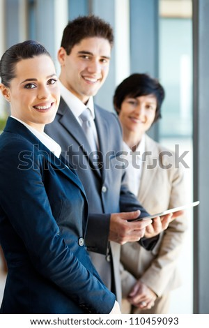 group of businesspeople with tablet computer - stock photo