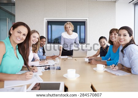 Group Of Businesswomen Meeting Around Boardroom Table - stock photo