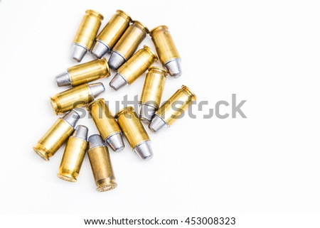 Group of 45 caliber bullets pistols ammo isolated on a white background. - stock photo
