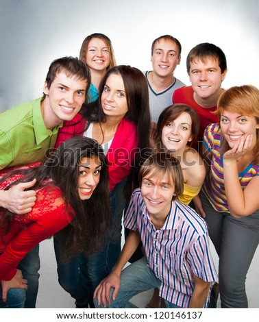group of casual happy people smiling and standing over a light background - stock photo