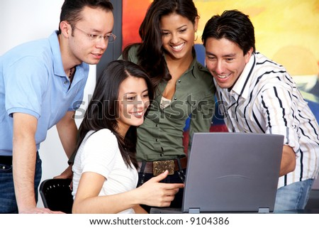 group of casual people on a computer at home - stock photo