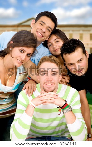 group of casual students at university outdoors on a sunny day - stock photo