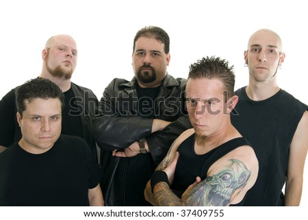 Group of Caucasian men wearing black with serious expressions - stock photo