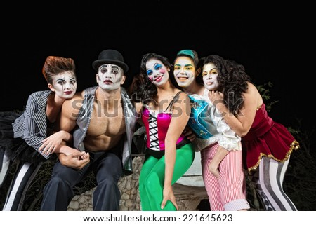Group of character clowns posing on stage - stock photo