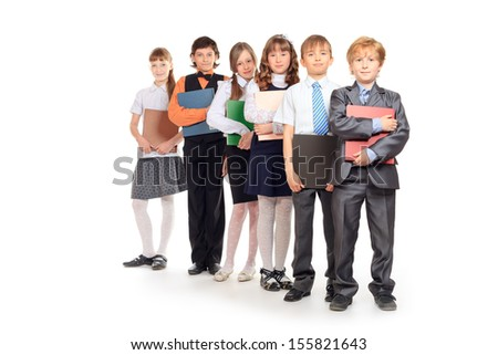 Group of cheerful children standing with books. Isolated over white. - stock photo