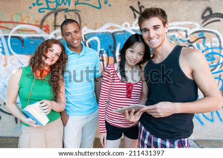 Group of cheerful friends. multi ethnic outdoors - stock photo