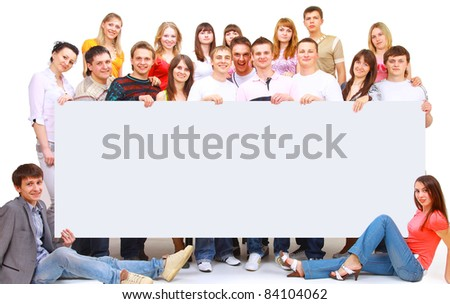 Group of cheerful people holding a banne - stock photo