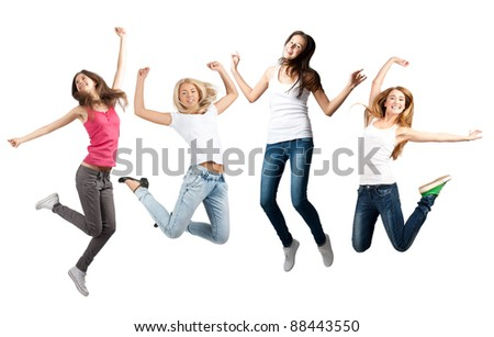 Group of cheerful young women jumping in air. Isolated on white background - stock photo