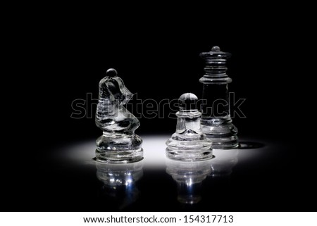 Group of chessmen in the light - stock photo