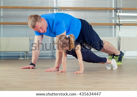 Group of children doing kids gymnastics in gym with nursery teacher - stock photo