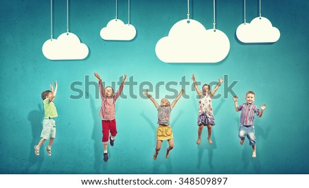 Group of children jumping high joyfully on colorful background - stock photo