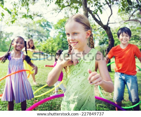 Group of Children Playing Hulahoop Concept - stock photo