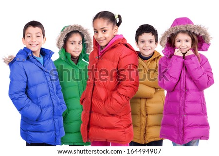 Group of children posing in colorful winter coats isolated in white - stock photo