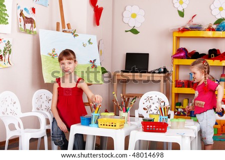 Group of children preschooler with colour pencil in play room. - stock photo