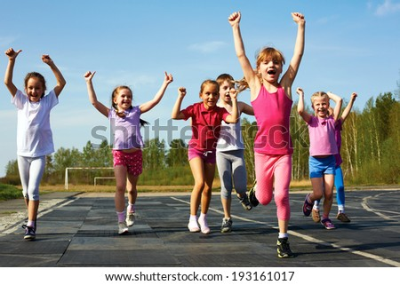 group of children running on the treadmill at the stadium - stock photo