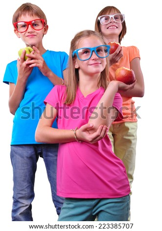 Group of children with apples wearing eyeglasses isolated over white . Childhood, happiness, active lifestyle concept - stock photo