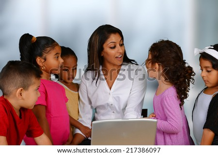 Group of children working on the computer at school - stock photo