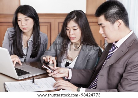 Group of Chinese business people working together in the office - stock photo