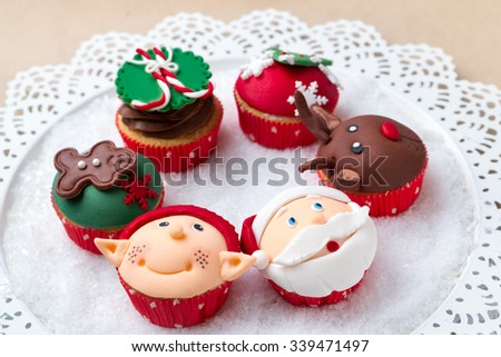 Group of Christmas cupcakes with decorative symbols elements - stock photo