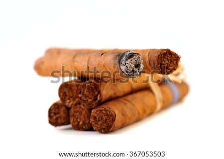 Group of cigars on white background - stock photo