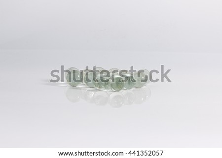 group of clear marbles on white background  - stock photo