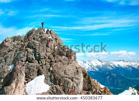 Group of climbers reaches the top of mountain peak. Climbing and mountaineering sport. Teamwork concept. - stock photo