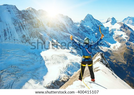 Group of  climbers reaching the summit, Nepal Himalayas - stock photo