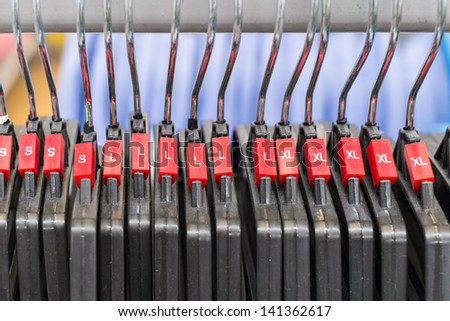 group of cloth hanger with red sizing label in row - stock photo