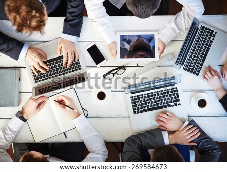 Group of colleagues networking at meeting - stock photo