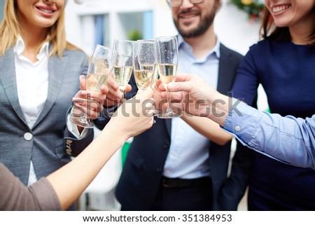 Group of colleagues toasting with champagne - stock photo