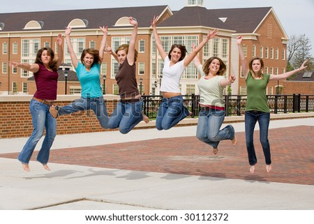 Group of College Girls Jumping - stock photo