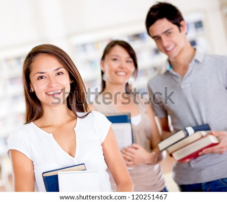 Group of college students at the library - stock photo