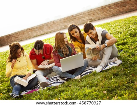 Group of college students outside - stock photo