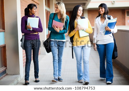 group of college students walking to lecture hall - stock photo
