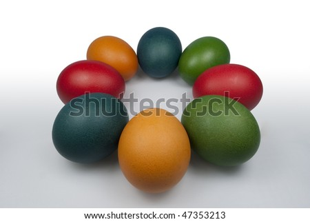 Group of Colored Easter Eggs on the white background. Circle of Eggs - stock photo