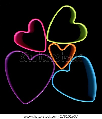 group of colorful hearts on black background - stock photo