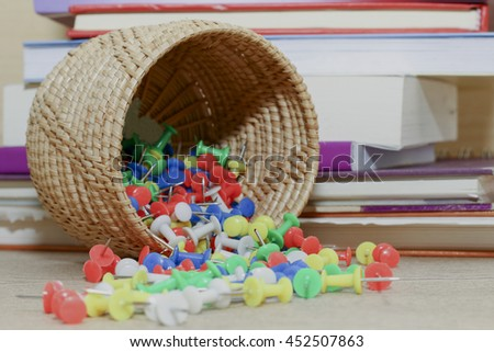 group of colorful pin on desk with books,colorful of pin - stock photo