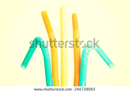 Group of colorful straws in vertical view.  - stock photo