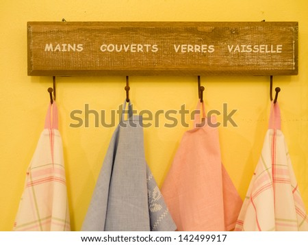 Group of colorful Tablecloth on hanger at kitchen - stock photo