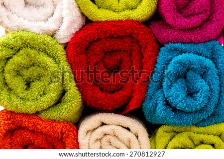 Group of colorful towels rolled up, background - stock photo