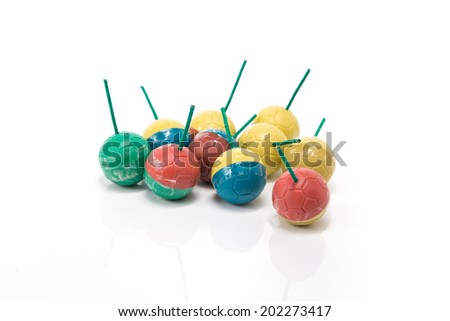 group of colourful bomb with slate green or firework sound of thailand on isolate white background. - stock photo