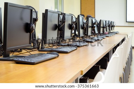 Group of computer neatly placed in a computer lab. - stock photo