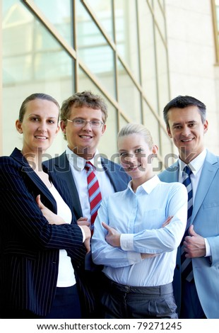 Group of confident business partners looking at camera outside - stock photo