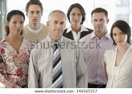 Group of confident multiracial business people standing together in office - stock photo