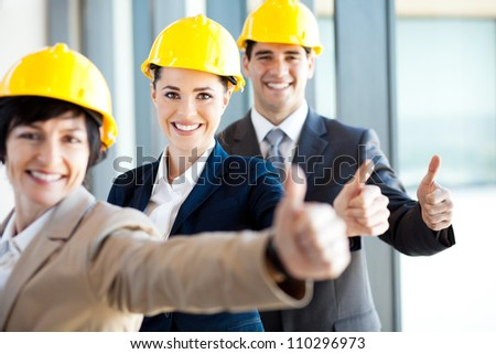 group of construction manager thumbs up - stock photo