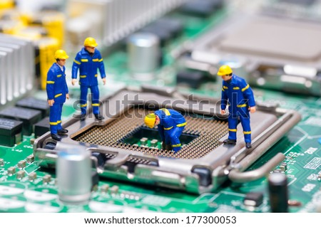 Group of construction workers repairing CPU. Technology concept - stock photo