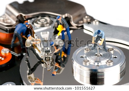 Group of construction workers repairing hard disk drive - stock photo