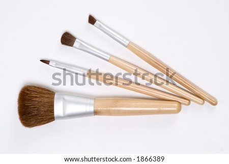 Group of cosmetic brushes on a white background - stock photo